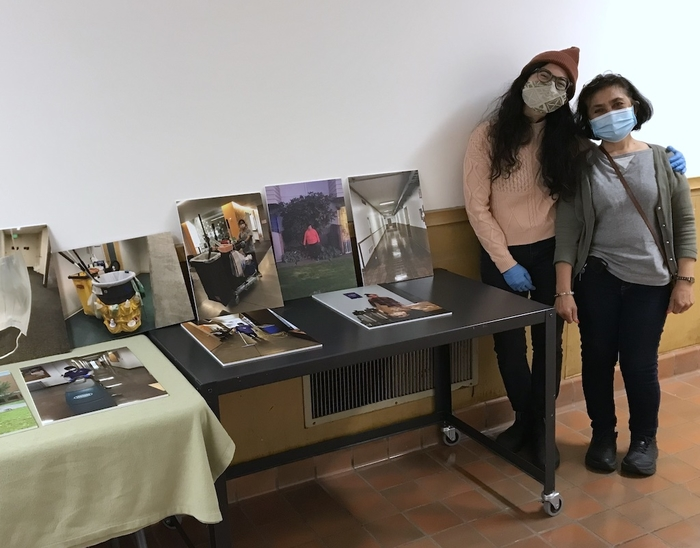 Evalynn Romano and her mother Evalina Romano next to tables with photographs