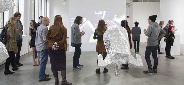 Students in exhibition gallery