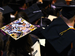 Graduating students with decorated caps