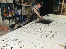 Amanda Pickler working in Jono Vaughan's studio