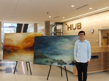 Kewei Zhu with paintings that won the 2016 HUB Director's Award