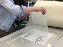 Student doing paper litho