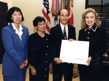 Ron Chew and others receiving IMS award from Hilary Clinton